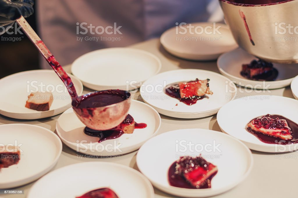 Meat topped with delicious hot cherry sauce stock photo