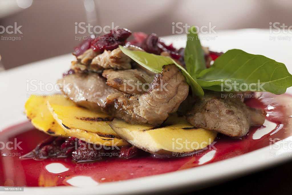 meat with mango and cherry sauce stock photo