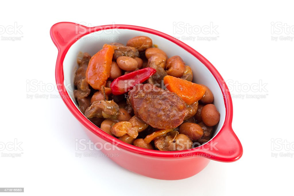 meat with sausages and beans in the bowl royalty-free stock photo