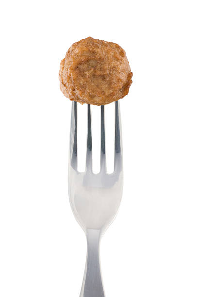 Meatball and fork Meatball and shiny fork. Isolated on pure white. Clipping path included.See also: meatball stock pictures, royalty-free photos & images