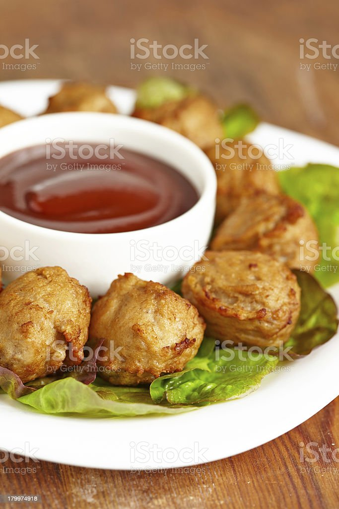 Meatball appetizers with a dipping sauce royalty-free stock photo