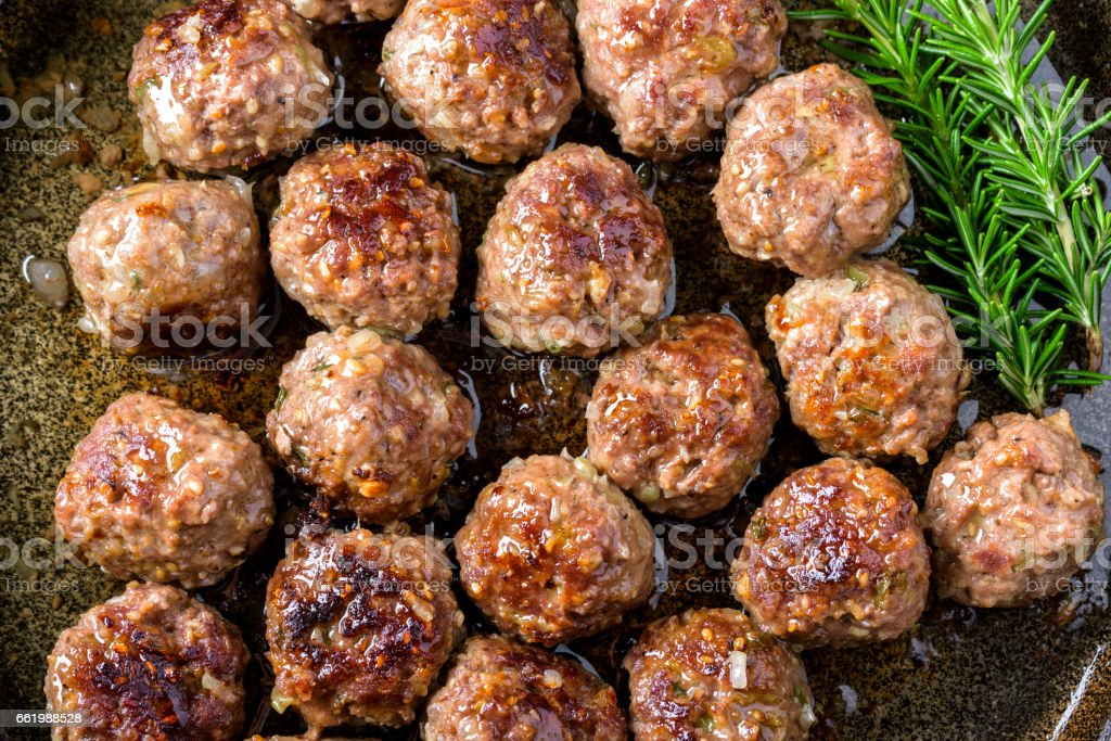 Meatball in cast iron pan royalty-free stock photo