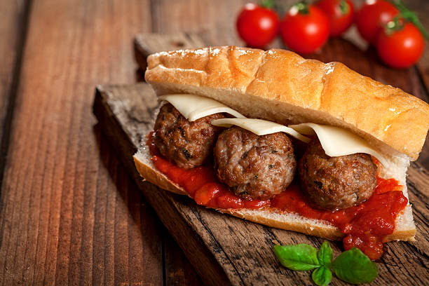 Meatball sendwich in tomato sauce meatball sandwich submarine sandwich stock pictures, royalty-free photos & images