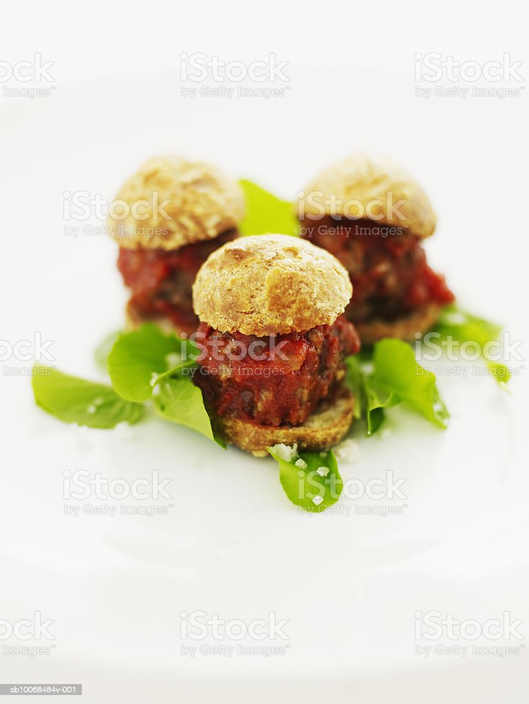 Meatball sliders in gouger pastry with watercress and sea salt, close-up foto de stock libre de derechos