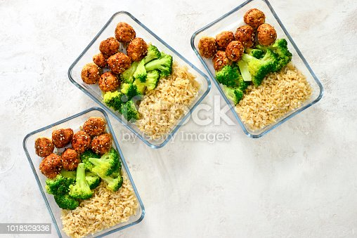 Meatballs and broccoli and rice lunch boxes cooked in advance and ready to be frozen or to be served for lunch, view from above