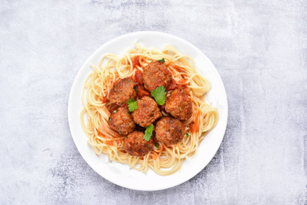 Meatballs and spaghetti Spaghetti pasta with meatballs and tomato sauce, top view meatball stock pictures, royalty-free photos & images