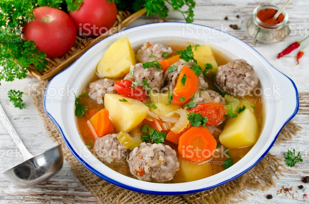Meatballs in a thick vegetable soup Albondigas stock photo