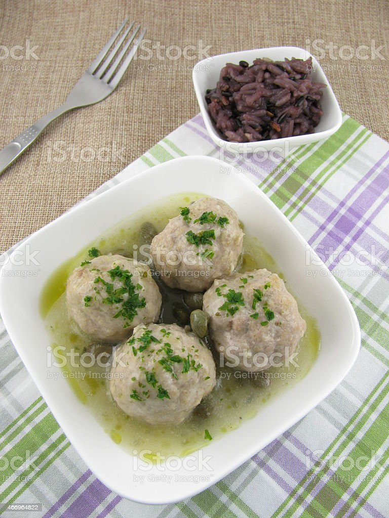 Meatballs in caper sauce with rice stock photo