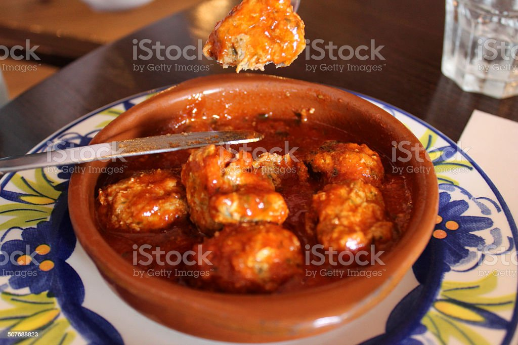 Meatballs in earthenware dish, part of Tapas meal at Spanish-restaurant stock photo