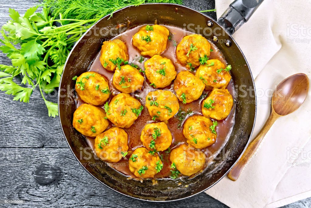 Meatballs in pan on board top stock photo