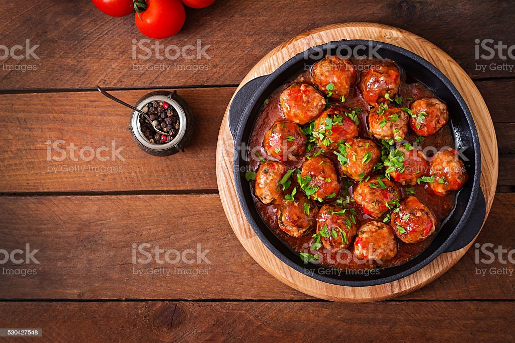 Meatballs in sweet and sour tomato sauce stock photo