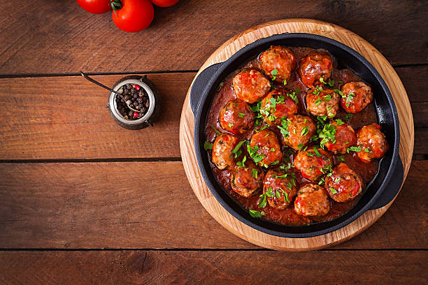 Meatballs in sweet and sour tomato sauce Meatballs in sweet and sour tomato sauce. Top view meatball stock pictures, royalty-free photos & images