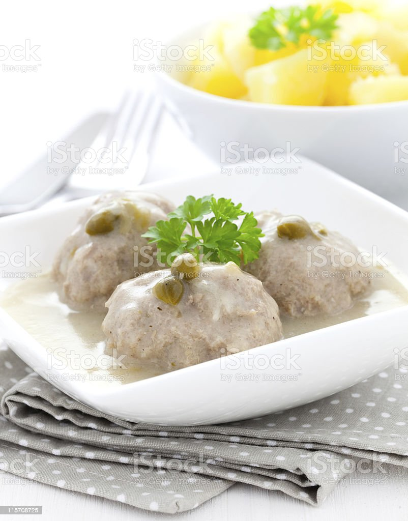 meatballs in white sauce stock photo