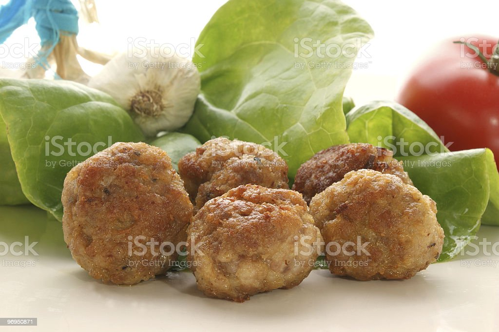 meatballs on a plate with salad royalty-free stock photo