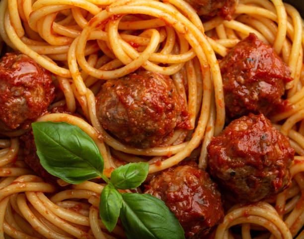 Meatballs pasta in tomato sauce Close-up of delicious meatballs pasta with tomato sauce, from above. Tasty homemade meatballs spaghetti concept, food pattern background spaghetti stock pictures, royalty-free photos & images
