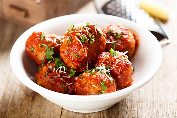 Meatballs Meatballs in tomato sauce meatball stock pictures, royalty-free photos & images