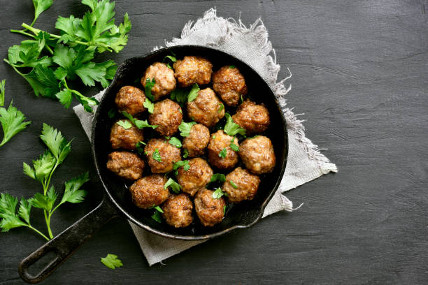 Meatballs Meatballs in frying pan on black stone background with copy space. Top view, flat lay meatball stock pictures, royalty-free photos & images