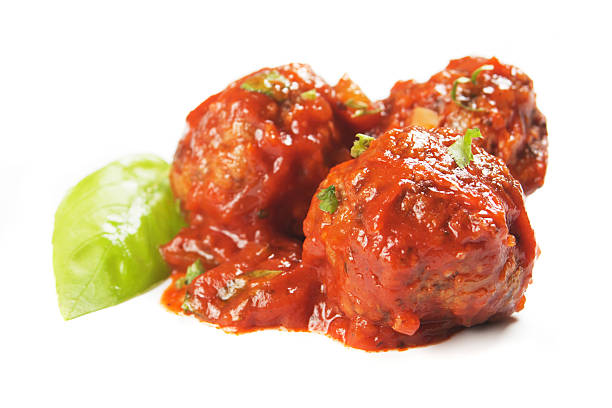 Meatballs with tomato sauce Meatballs in tomato sauce isolated on white background meatball stock pictures, royalty-free photos & images