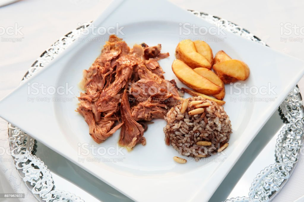 Meats with Garnish Plate on Restaurant Table stock photo