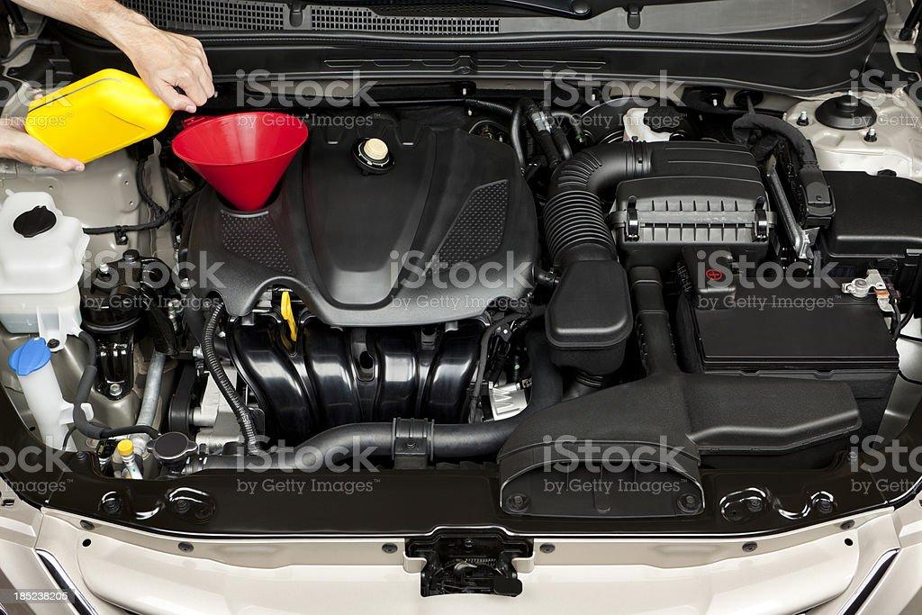 Mechanic Adding Engine Oil stock photo