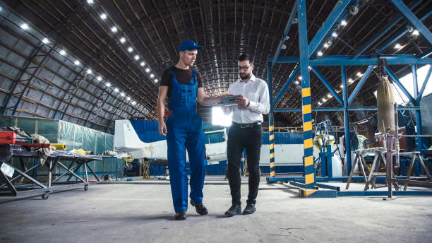 Mechanic and flight engineer having a discussion stock photo