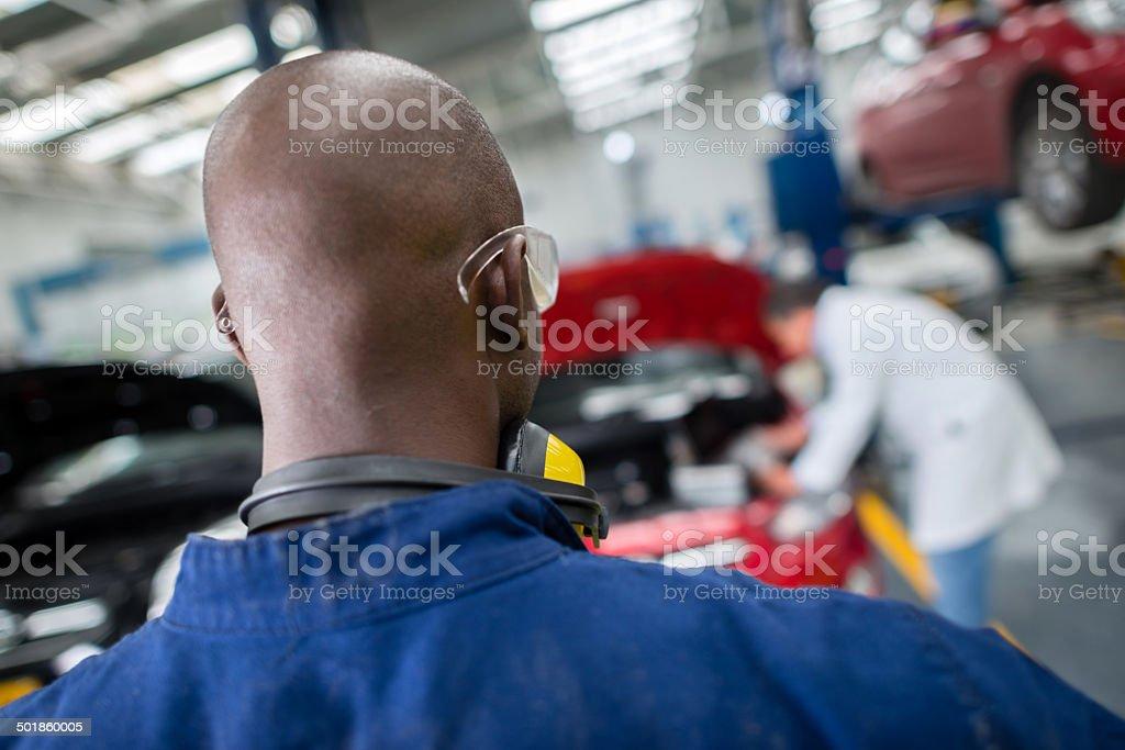 Mechanic at a car garage royalty-free stock photo