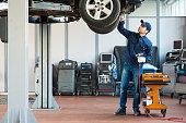 istock Mechanic at work in his garage 470932824
