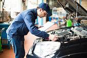 istock Mechanic at work in his garage 473909642