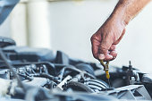 istock Mechanic Car Service in automobile garage auto car and vehicles service mechanical engineering. Automobile mechanic hands car repairs automotive technician workshop center. Services car engine machine 1211170122