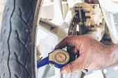 istock Mechanic Car Service in automobile garage auto car and vehicles service mechanical engineering. Automobile mechanic hands car repairs automotive technician workshop center. Services car engine machine 1211170134
