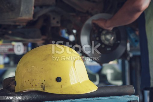 962888586 istock photo Mechanic Car Service in automobile garage auto car and vehicles service mechanical engineering. Automobile mechanic hands car repairs automotive technician workshop center. Services car engine machine 1252842880