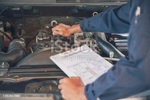 962888586 istock photo Mechanic Car Service in automobile garage auto car and vehicles service mechanical engineering. Automobile mechanic hands car repairs automotive technician workshop center. Services car engine machine 1252842882