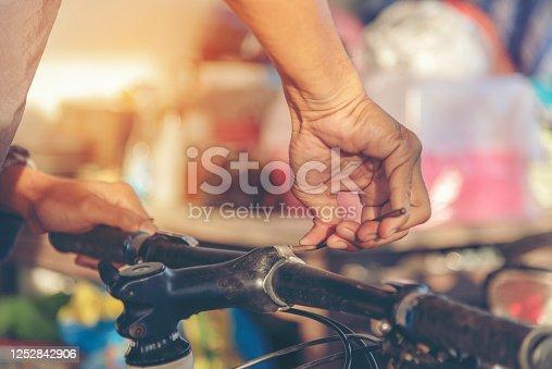 962888586 istock photo Mechanic Car Service in automobile garage auto car and vehicles service mechanical engineering. Automobile mechanic hands car repairs automotive technician workshop center. Services car engine machine 1252842906