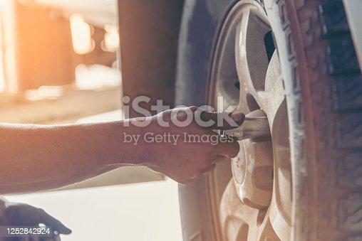 962888586 istock photo Mechanic Car Service in automobile garage auto car and vehicles service mechanical engineering. Automobile mechanic hands car repairs automotive technician workshop center. Services car engine machine 1252842924