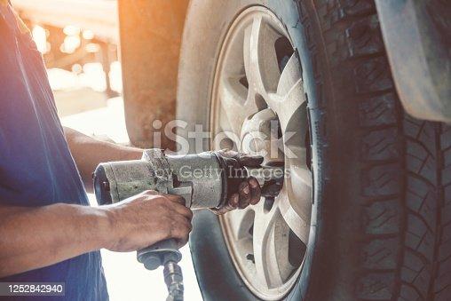 962888586 istock photo Mechanic Car Service in automobile garage auto car and vehicles service mechanical engineering. Automobile mechanic hands car repairs automotive technician workshop center. Services car engine machine 1252842940