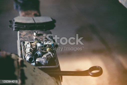962888586 istock photo Mechanic Car Service in automobile garage auto car and vehicles service mechanical engineering. Automobile mechanic hands car repairs automotive technician workshop center. Services car engine machine 1252844015