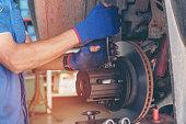 istock Mechanic Car Service in automotive garage auto car center and vehicles service mechanical engineering. Technician mechanic hands car repairs workshop service center. Services car engine machine. 1211214752