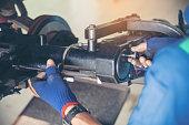 istock Mechanic Car Service in automotive garage auto car center and vehicles service mechanical engineering. Technician mechanic hands car repairs workshop service center. Services car engine machine. 1211214754