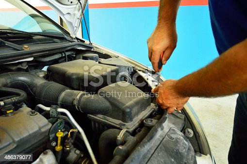 1073743202 istock photo Mechanic change air filter in a diesel engine car 486379077
