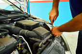 istock Mechanic change air filter in a diesel engine car 486379077