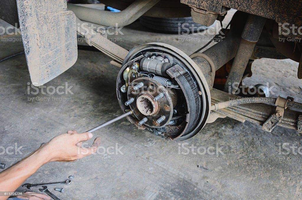 mechanic changing maintenance Disc brake on car stock photo
