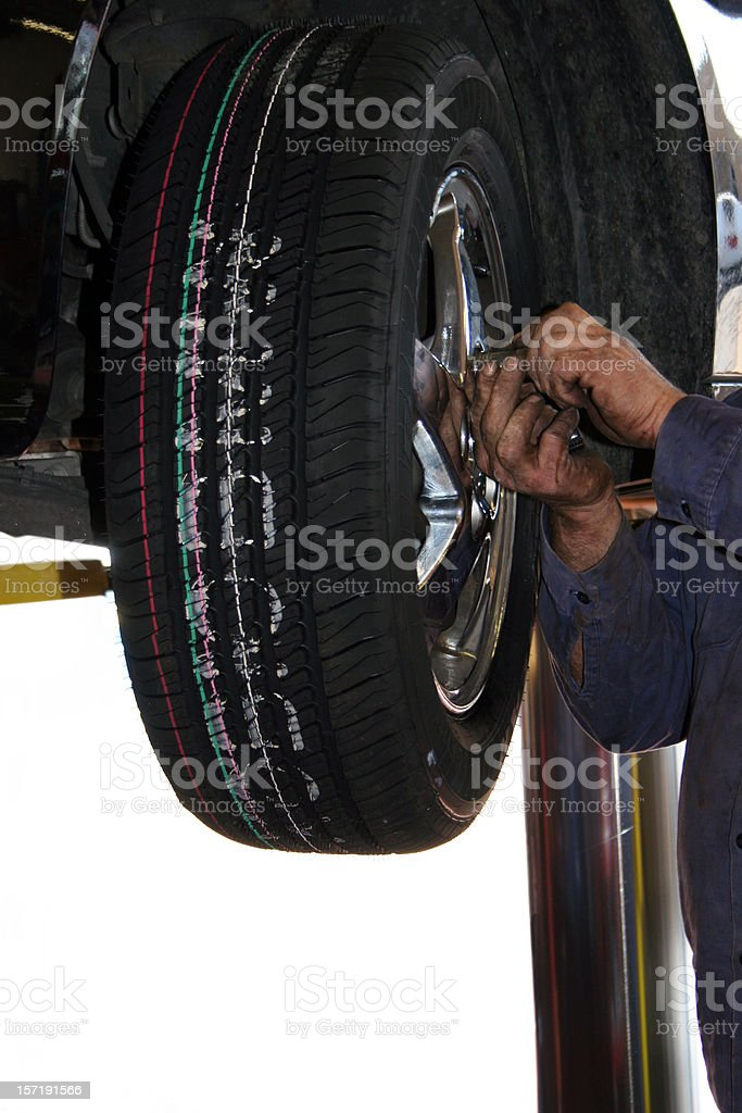 Mechanic Changing Tire Vertical royalty-free stock photo