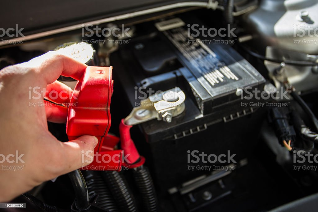 Mechanic checking car battery stock photo
