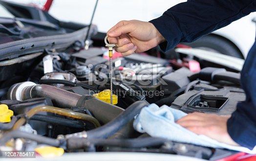 1137474295 istock photo A mechanic  checking car transmission 1208785417
