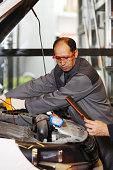 istock Mechanic checking engine 187071633