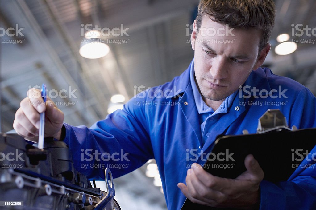 Mechanic checking engine stock photo