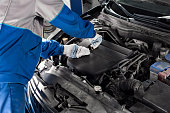 istock Mechanic checking oil level in a car workshop 849731162