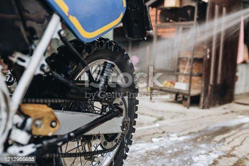 Motorcycle mechanic washing his motorcycle