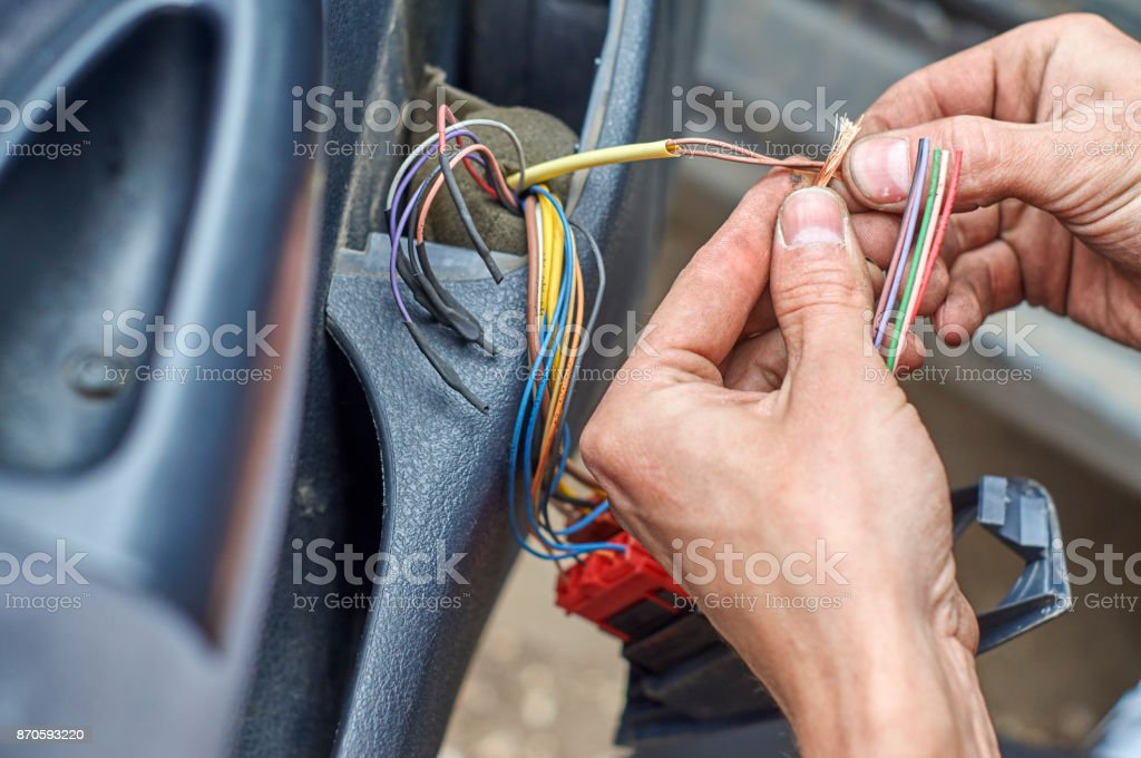 mechanic connecting electrical cables in car door picture id870593220 mechanic connecting electrical cables in car door stock photo & more