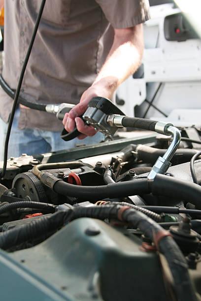 Mechanic Dispensing Motor Oil stock photo
